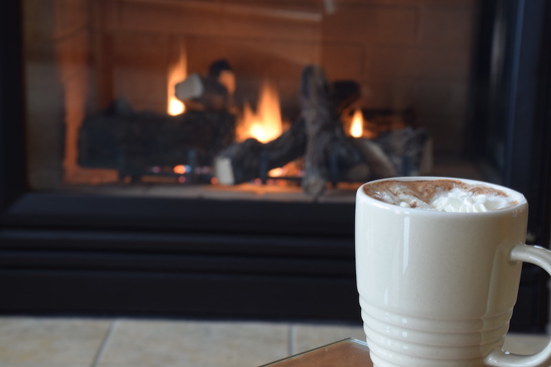 angelica king hot cocoa in front of the fireplace two harbors