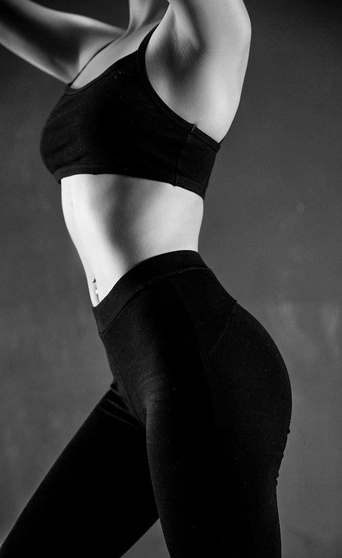 bicicleta-estatica-para-adelgazar-chica-fitness