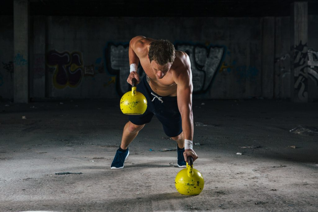 working out man with dumbbels PGMPWRL min